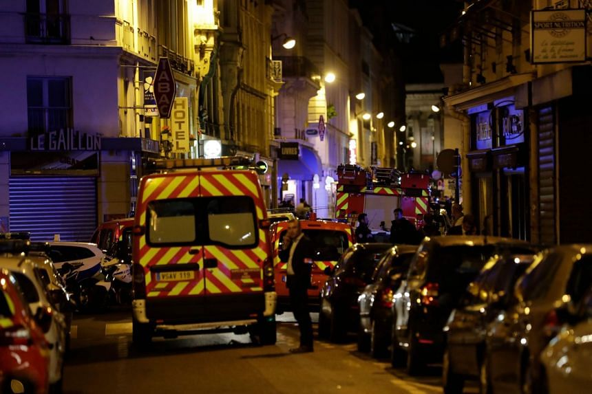 Firefighting vehicles block Saint Augustin street in Paris centre after the knife attack.