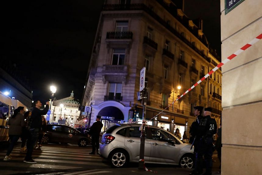 Police stand guard in Paris after one person was killed and several injured by a man armed with a knife.