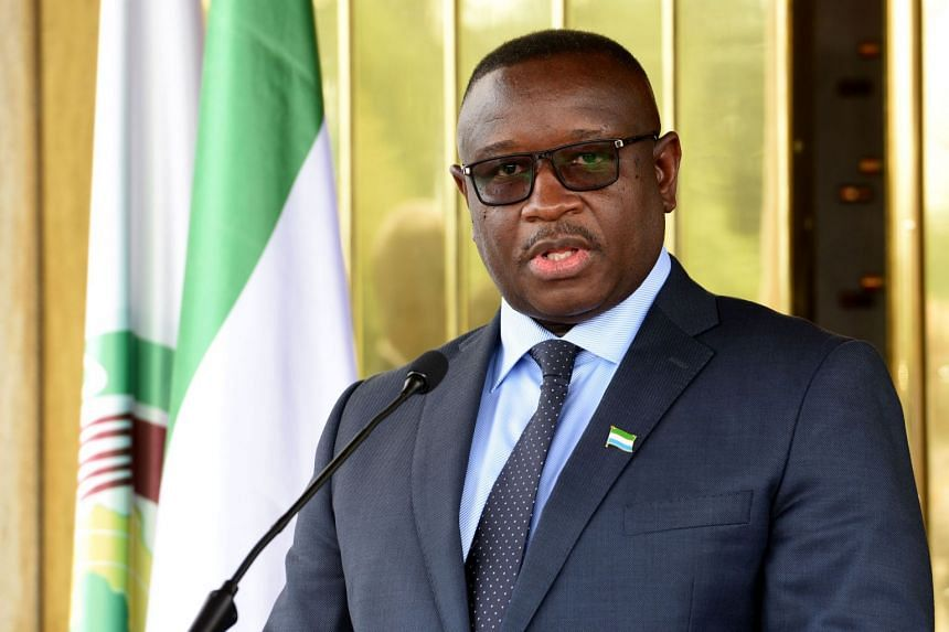 Thousands had gathered for the swearing-in of the country's new president, Julius Maada Bio (above).