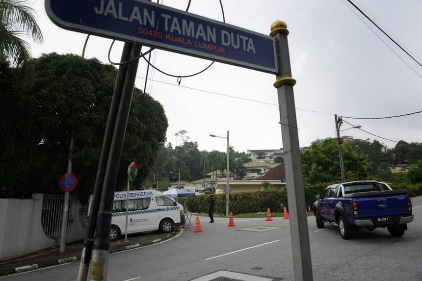 Police presence at the entrance of former Malaysian prime minister Najib Razak's residence on May 13, 2018.