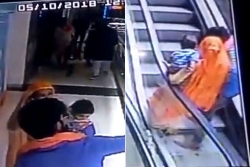 CCTV footage first showed the couple taking a selfie on a corridor. They then reportedly wanted to take another selfie on an escalator, during which the mother lost her balance and dropped her baby.