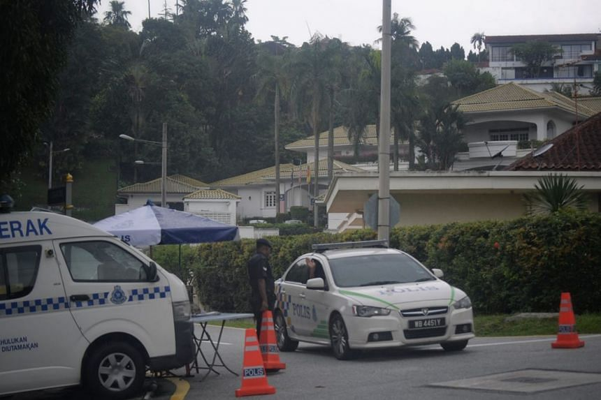 Police vehicles and personnel seen in the vicinity of the private residence of former Malaysian prime minister Najib Razak on May 13, 2018.