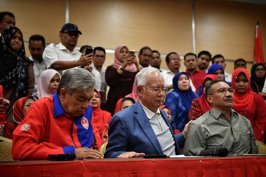 Mr Najib Razak announcing his resignation yesterday. With him are former deputy premier Ahmad Zahid Hamidi (far left) and former defence minister Hishammuddin Hussein.
