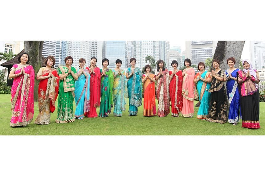 """Sixteen female MPs donned saris for a Tamil Murasu Deepavali photoshoot in 2016. Its news editor said most of the Singapore Indian community """"were positive and appreciative"""" but a minority saw it as cultural appropriation."""