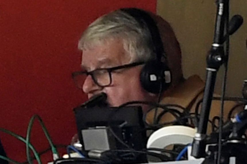 John Motson commentating on the Arsenal-Watford English Premier League match at the Gunners' Emirates Stadium on March 11, 2018.