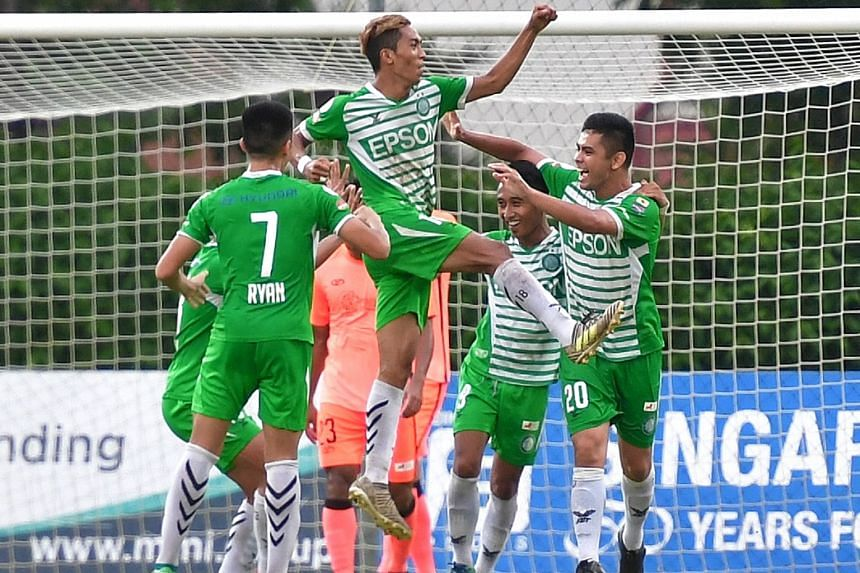 Geylang International's Shawal Anuar celebrating after heading in his second goal in their Singapore Premier League match at Hougang Stadium yesterday. Geylang beat Hougang 3-1.