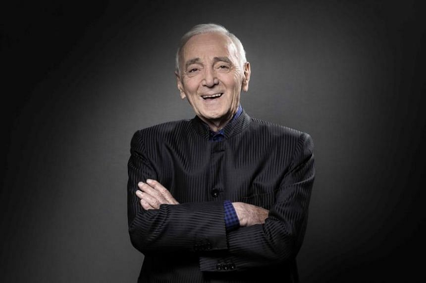French singer Charles Aznavour fractured his arm in a fall at home, but his representative said it was nothing serious.