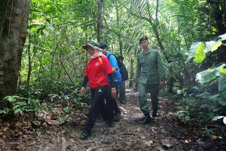 President Halimah Yacob walking through the jungle in Temburong to visit SAF officer cadets, during her trip to Brunei, on May 13, 2018.