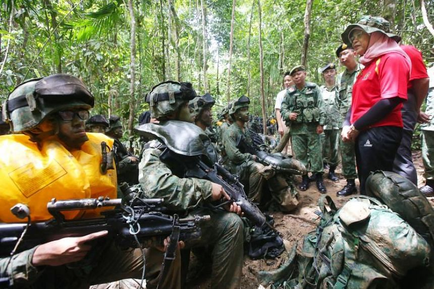 President Halimah Yacob speaking to SAF officer cadets during their jungle training in Temburong, on May 13, 2018.