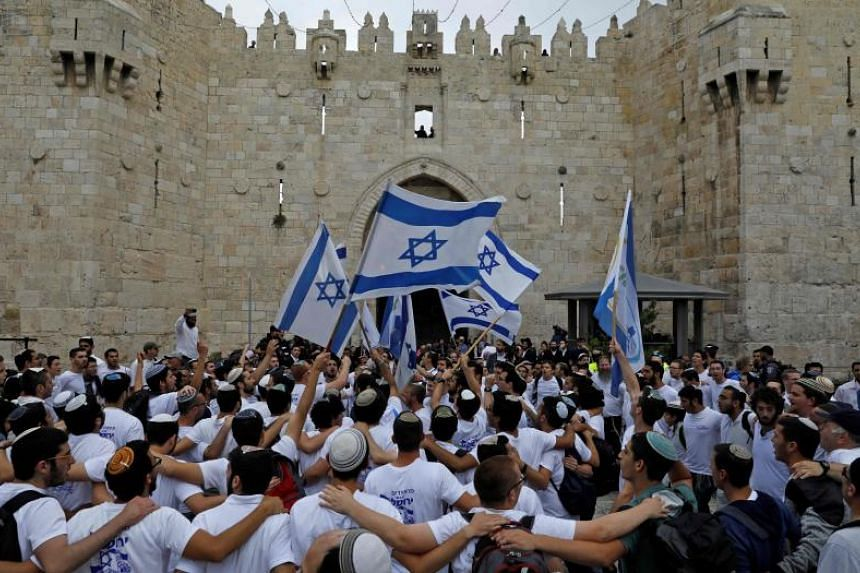 Israelis celebrating Jerusalem Day at the Old City's Damascus gate on May 13, 2018. Israel has approved a cable car project that would link the Old City with West Jerusalem.