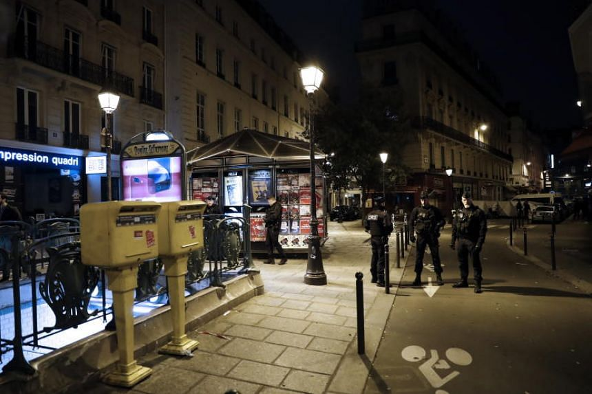French police stand guard next to the place where a man attacked and stabbed several people in Paris, France, on May 12, 2018.