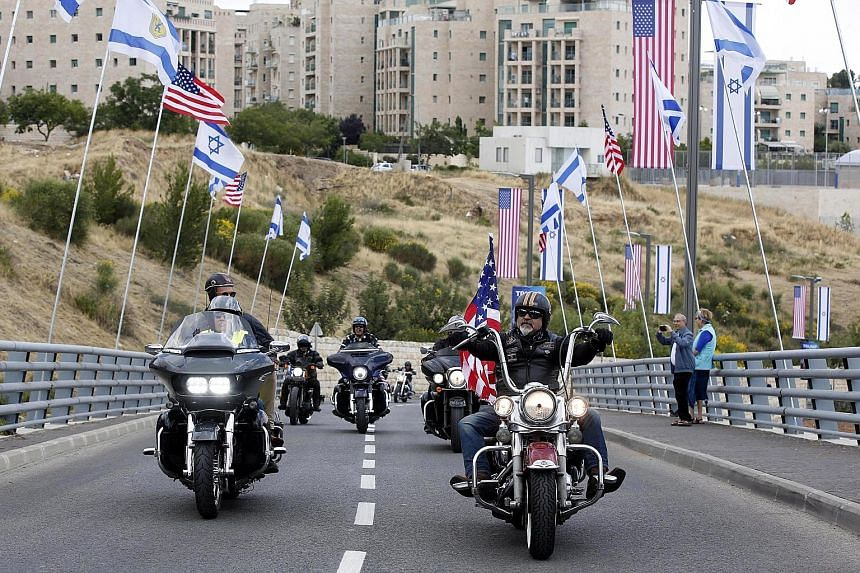 Israeli Harley Davidson bikers yesterday arriving outside the US consulate building in Jerusalem that will become the official US embassy from today.