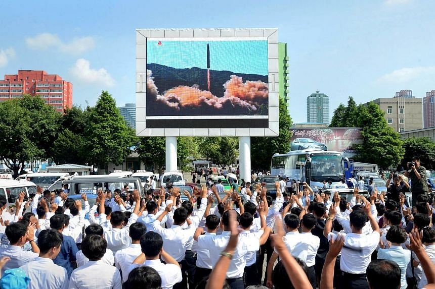 A file photo from July last year showing a public broadcast of North Korea's test launch of an intercontinental ballistic missile. To uphold its pledge to discontinue such nuclear and weapons tests, the North has scheduled the dismantlement of its nu