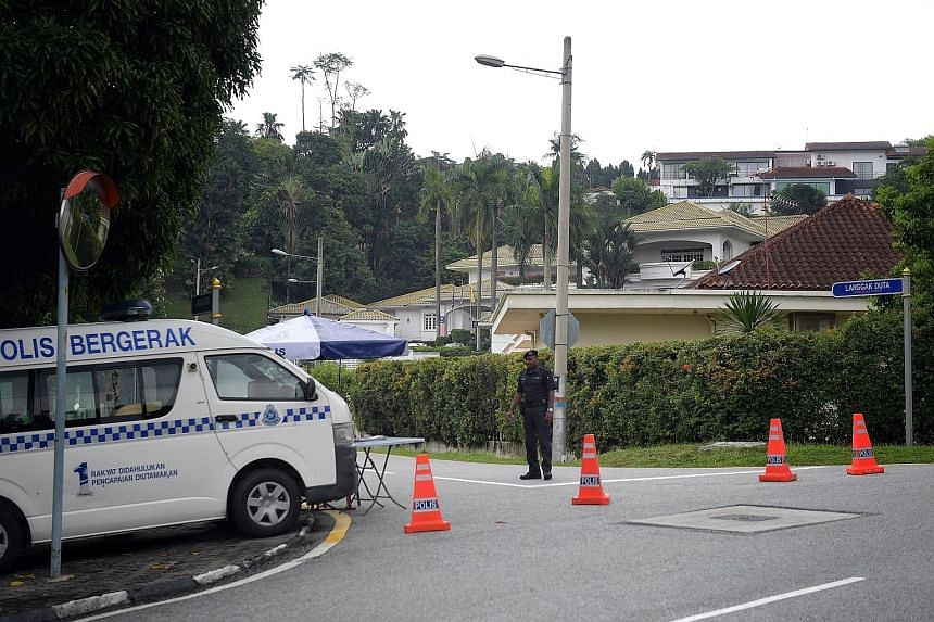 A police cordon at a road leading to former prime minister Najib Razak's private residence in the Taman Duta area of Kuala Lumpur. Police said they were there to monitor security.