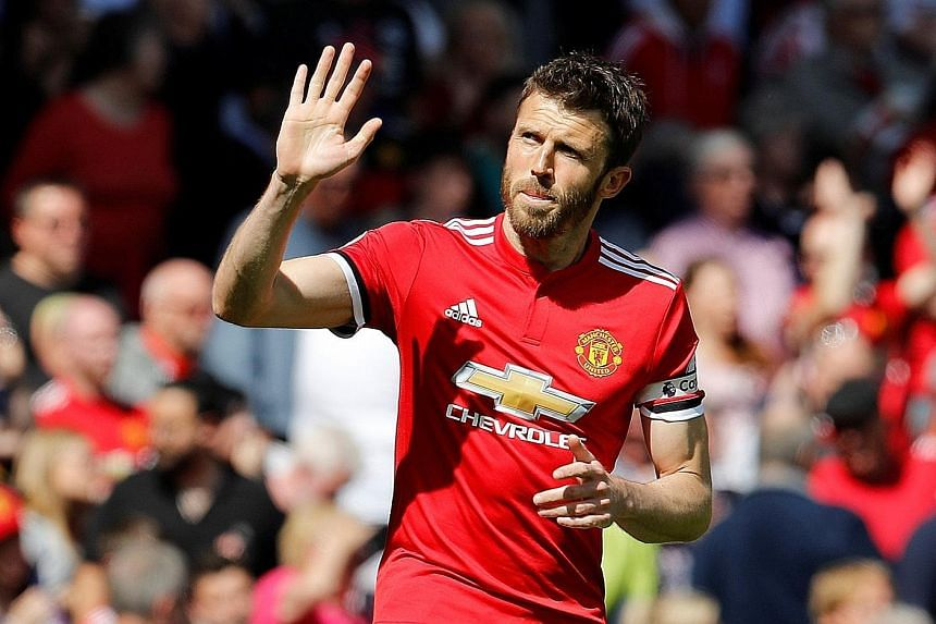 Michael Carrick wearing the captain's armband for the last time yesterday against Watford. His 12 years with the club brought 18 trophies, including five Premier League titles and the Champions League in 2008.