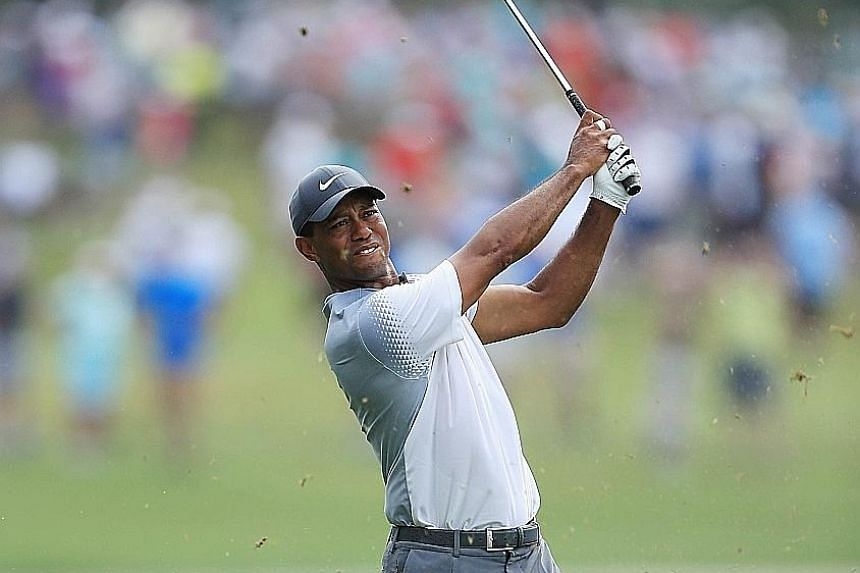 Tiger Woods plays a shot on the sixth hole during the third round of the Players Championship. The two-time winner of the tournament barely made the cut on Friday, but finished with a seven-under 65 on Saturday, the best round of his career at Sawgra