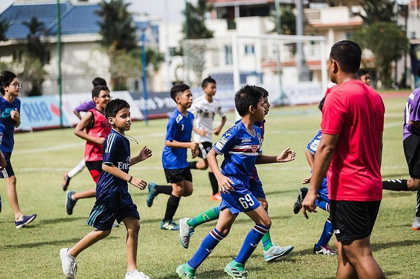 Children enjoying a kick-about at Choa Chu Kang Stadium yesterday, part of Warriors FC's Kids Day. It was held before the Singapore Premier League match between Warriors and Albirex Niigata. The latter won 2-1. The kick-about was one of many activiti