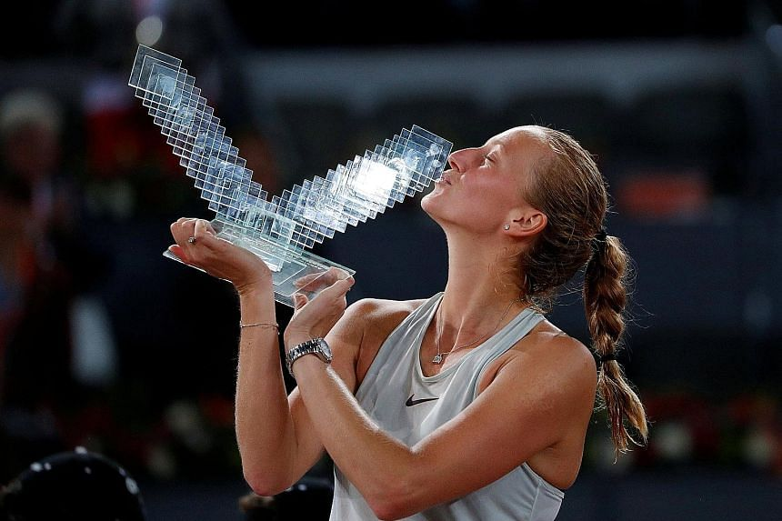 Petra Kvitova celebrates with the trophy after winning the Madrid Open final 7-6 (8-6), 4-6, 6-3 against Netherlands' Kiki Bertens.