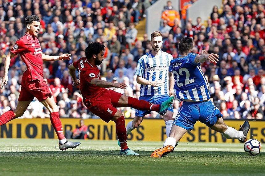 Mohamed Salah scoring the first goal in Liverpool's 4-0 win against Brighton yesterday. Having gone three matches without a goal, the Egyptian overtook the trio of Alan Shearer, Cristiano Ronaldo and Luis Suarez, who shared the previous best in a 38-