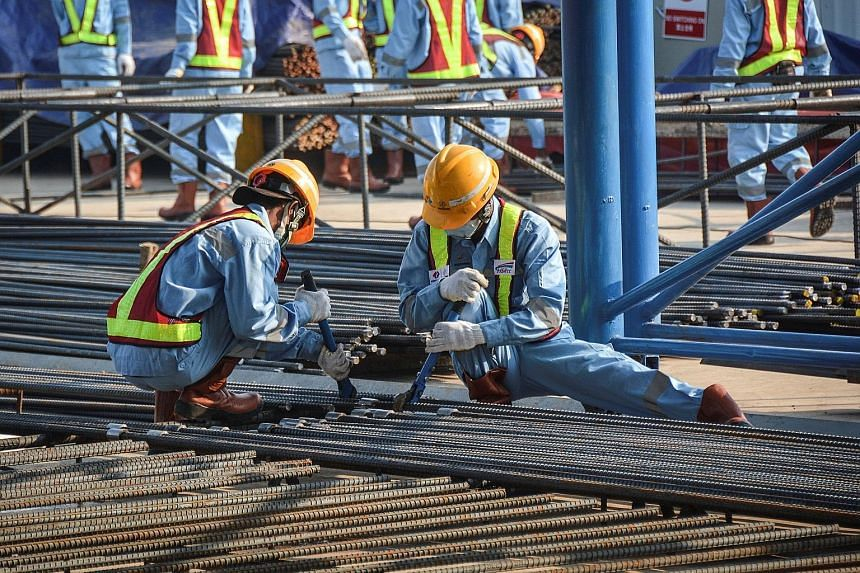 Workers preparing steel for the China-financed Jakarta-Bandung high-speed railway project. The project is the first in Indonesia under Chinese President Xi Jinping's Belt and Road Initiative.