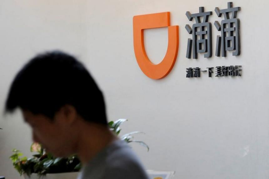 The logo of Didi Chuxing is seen at its headquarters in Beijing, China on May 18, 2016.