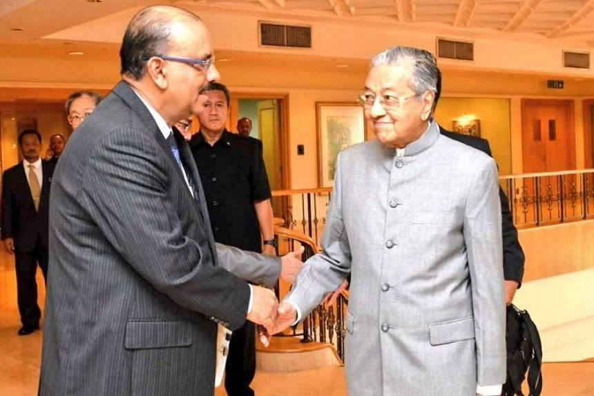 Prime Minister Mahathir Mohamad with Chief Secretary to the Government, Tan Sri Dr Ali Hamsa, on May 14, 2018.