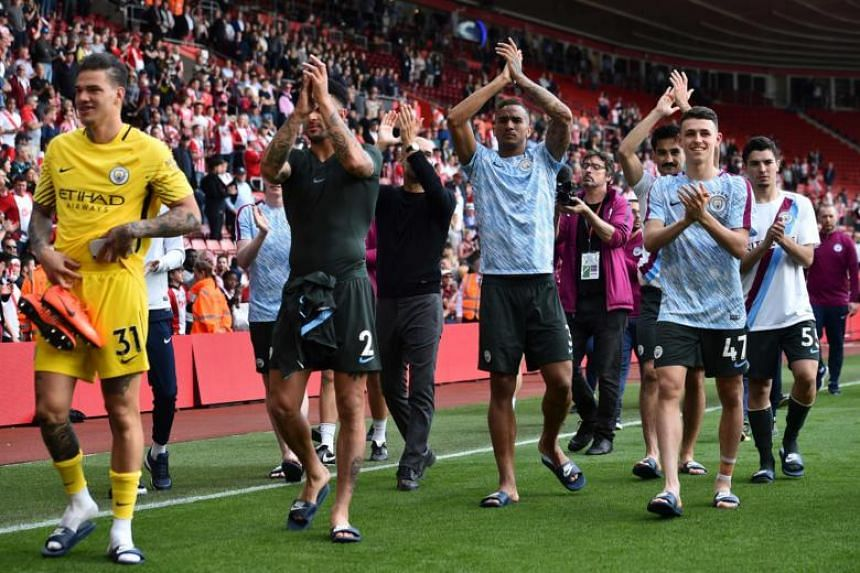 (From left) Manchester City's Ederson, Kyle Walker, Danilo and Phil Foden applauds the fans at the end of the English Premier League football match between Southampton and Manchester City at St Mary's Stadium in Southampton, southern England on May 1