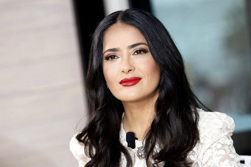 Actress Salma Hayek said male stars should get less pay as way to even things up with chronically underpaid women.