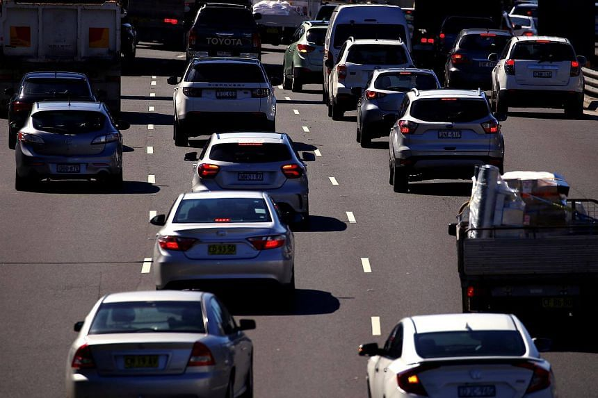 Cars drive along a main road during peak hour in Sydney, Australia, on Feb 28, 2018.