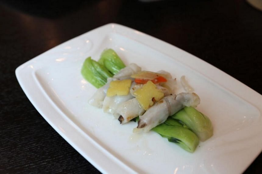 Restaurant Circa 1912 's pan-fried fish roll with asparagus.