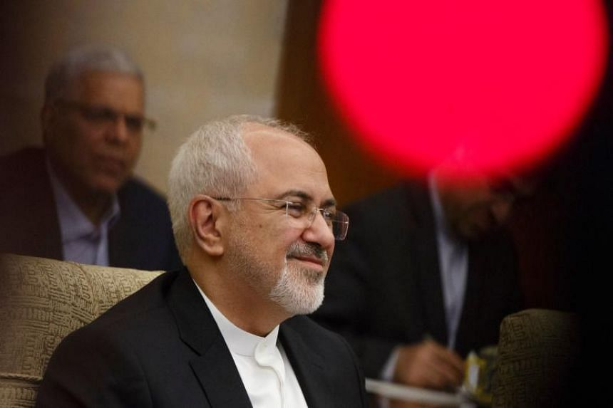 Iranian Foreign Minister Mohammad Javad Zarif holds talks with Chinese State Councillor and Foreign Minister Wang Yi (not pictured) at the Diaoyutai state guesthouse in Beijing on May 13, 2018.