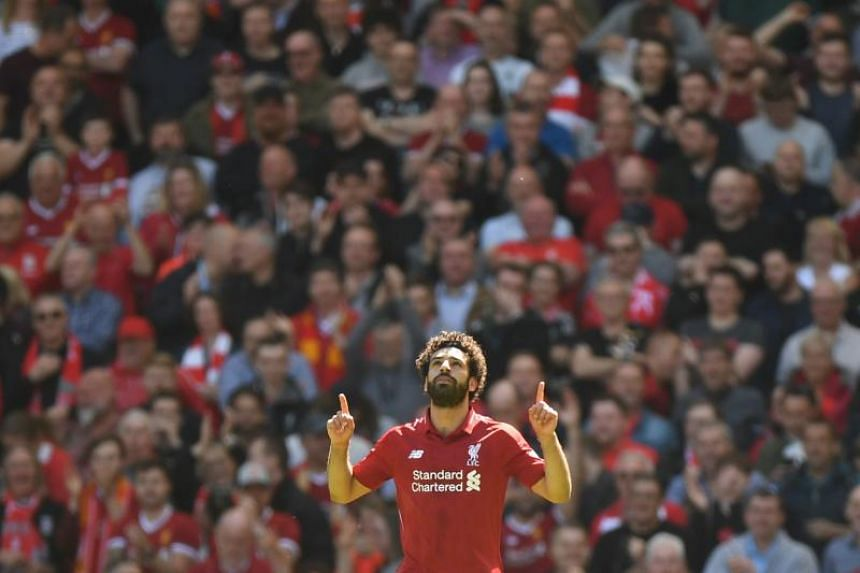 Liverpool's Egyptian midfielder Mohamed Salah celebrates after scoring during the English Premier League football match between Liverpool and Brighton and Hove Albion at Anfield in Liverpool, north west England on May 13, 2018.