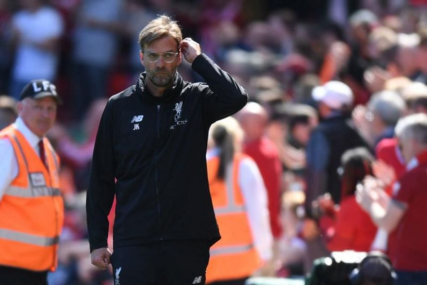 Liverpool's German manager Jurgen Klopp looks on during the English Premier League football match between Liverpool and Brighton and Hove Albion at Anfield in Liverpool, north west England on May 13, 2018.