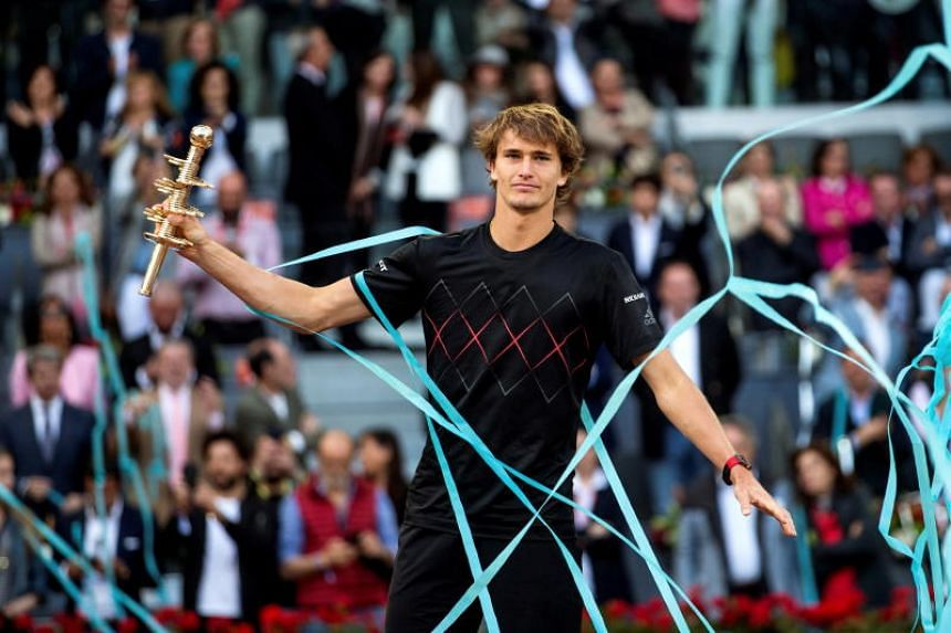 German tennis player Alexander Zverev celebrates his victory over Austrian Dominic Thiem at the end of their Mutua Madrid Open Men's final match at Caja Magica in Madrid, Spain, on May 13, 2018.