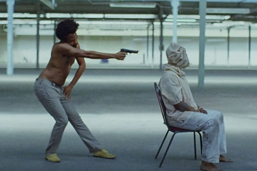This Is America - by actor and recording artist Donald Glover's (left) edgy alter ego, Childish Gambino, - is a raw take on racism, gun violence and consumer society.
