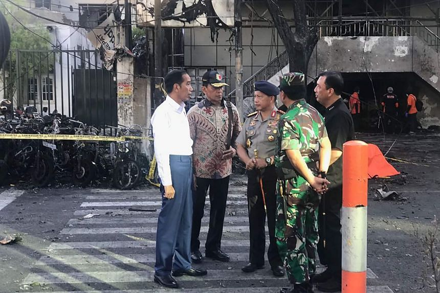 Indonesia's President Joko Widodo (left), National Police Chief Tito Karnavian (centre), Coordinating Minister for Social, Political, Legal and Security Affairs Wiranto (second, left), and Armed Forces Chief Hadi Tjahjanto at the scene of the attack