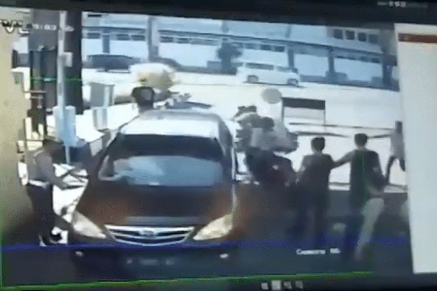 Closed-circuit television footage of the attack showed a two-wheeler being stopped by officers at the gates of Surabaya police headquarters shortly before the bomber detonated his explosives.