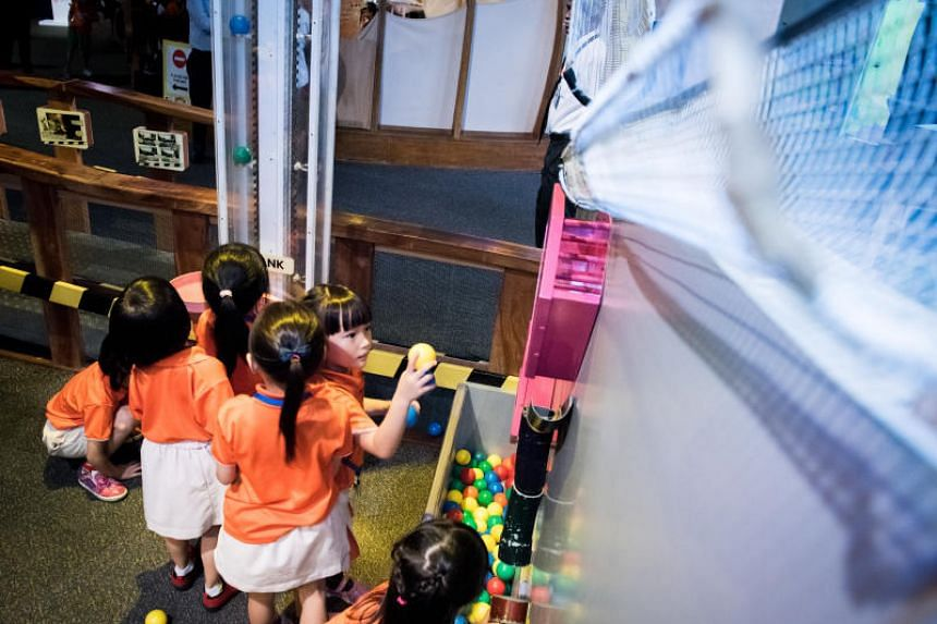 Pre-schoolers take part in activities during the launch of the new interactive exhibits at KidsSTOP.