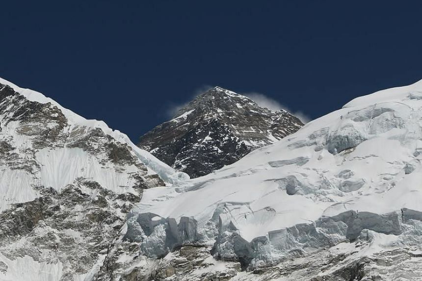File photo showing mountaineers pushing for the summit of Mount Everest as they climb the south face of the mountain from Nepal.