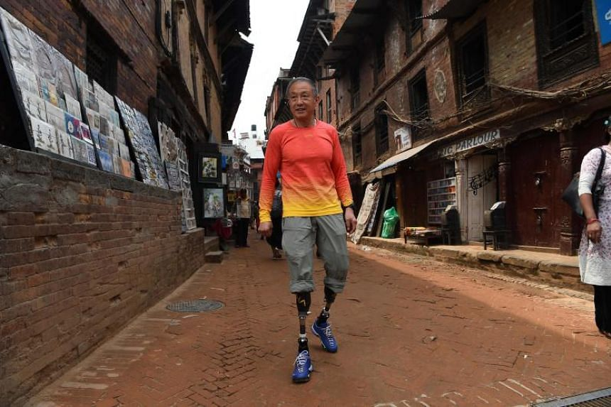 Chinese double amputee climber Xia Boyu, who lost both of his legs during first attempt to climb Everest, walking in Bhaktapur, Nepal, on April 4, 2018.