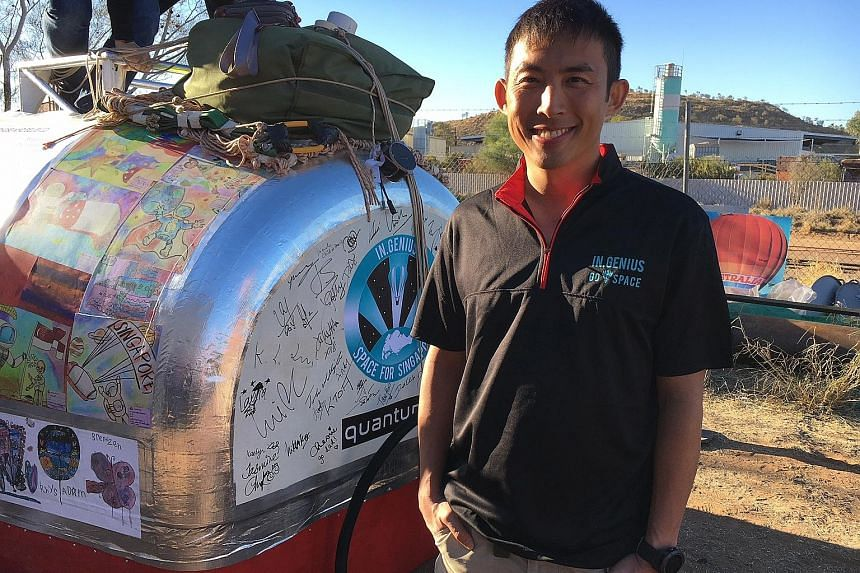 Singaporean air force pilot Yip Chuang Syn with the launch capsule in Alice Springs, Australia, yesterday.