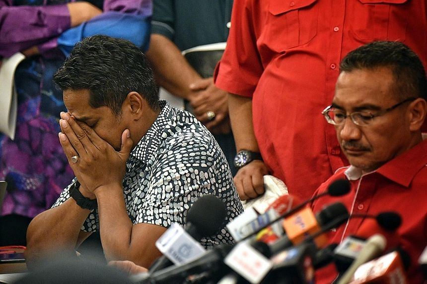 Umno Youth leader Khairy Jamaluddin (at right) and acting Umno deputy president Hishammuddin Hussein at a press conference in Kuala Lumpur yesterday. Mr Khairy said the focus should be on stabilising and reforming the party.