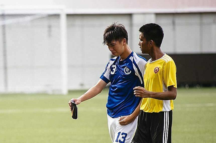Victoria Junior College's Marcus Tang (in yellow, heading the ball) was a big presence at both ends in yesterday's A Division boys' final. Not only did he help his school keep a clean sheet against Meridian Junior College, he also scored the winner a