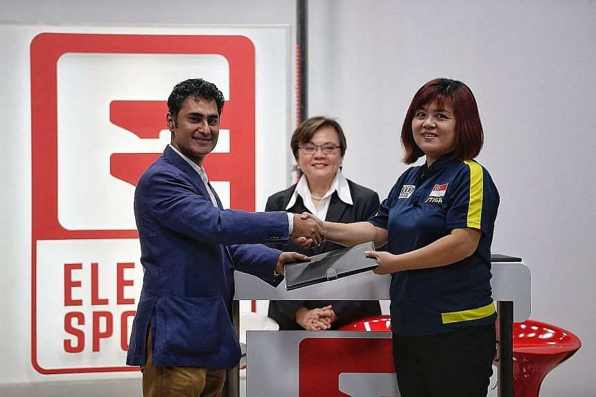 From left: Eleven Sports managing director Shalu Wasu, Singapore Table Tennis Association president Ellen Lee and STTA CEO Wong Hui Leng at the signing ceremony at Eleven Sports' studio at Media Circle yesterday.