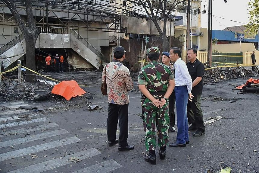 President Joko Widodo (second from right) visiting the scene of a suicide blast outside the Surabaya Centre Pentecostal Church.