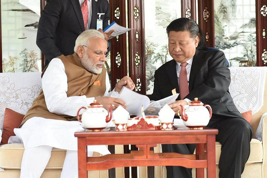 Chinese President Xi Jinping and India's Prime Minister Narendra Modi taking a boat ride on the East Lake in Wuhan, China, on April 28, 2018.
