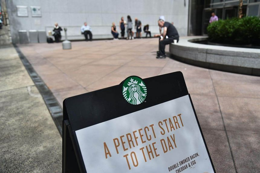 A sign for Starbucks is seen on a street in New York City on May 11, 2018.