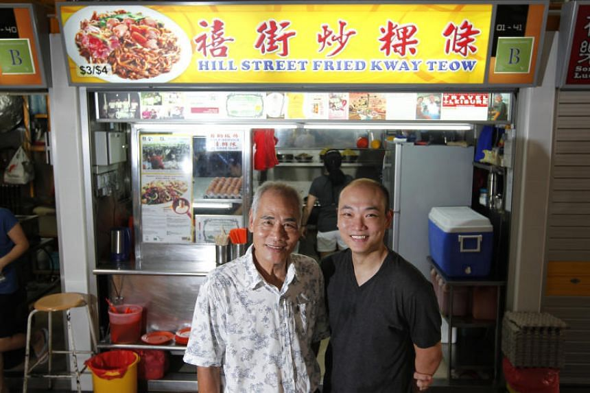 Hill Street Fried Kway Teow founder Ng Chang Siang (left) with his son, Mr Ng Yeow Kiat, at their stall in Bedok South Market & Food Centre.