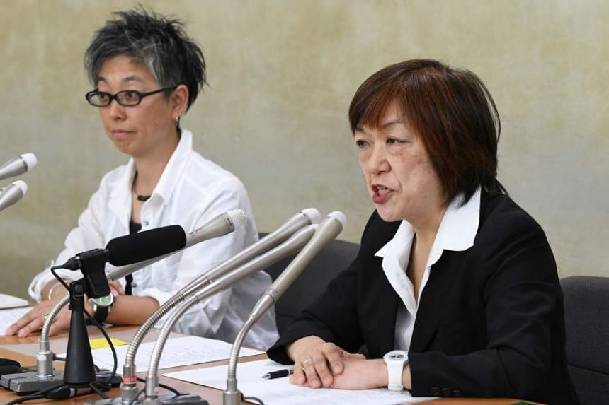Japanese journalist Yoshiko Hayashi (right) speaks during a press conference in Tokyo on May 15, 2018.