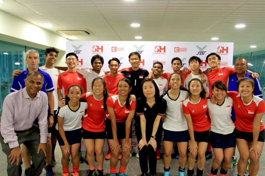 Members of the national men's and women's hockey teams with Singapore Hockey Federation president Mathavan Devadas (front row, left) and Panyasingha Sports & Trading Co director Olivia Wong.
